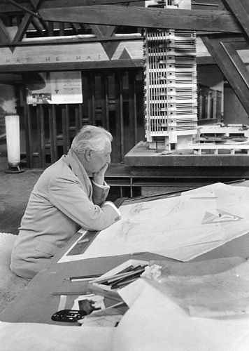 Frank Lloyd Wright in the drafting room at Taliesin, Spring Green, 1957.  Price Tower project model next to his desk. - photo by Bill Ray