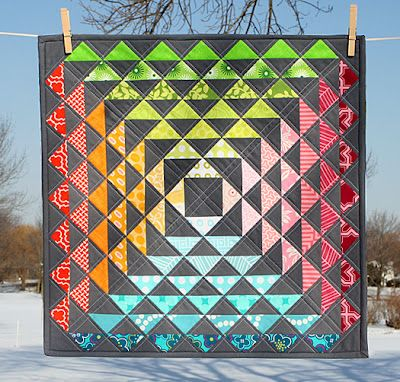 """I'm in love with this """"Modern Mini Challenge Quilt: HST Extravaganza"""" by Lee Heinrich of Freshly Pieced."""