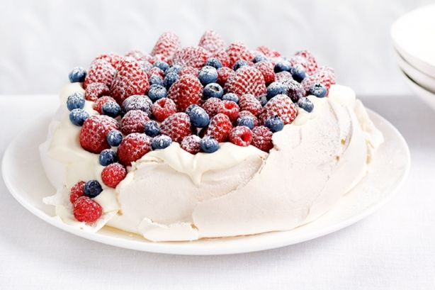 Berry-topped Pavlova: 150ml egg white (whites of approximately 4 eggs);   1 cup (220g; or ~8oz.) caster (superfine) sugar;   2 tablespoons (~1.5 fluid oz.) corn flour; (corn starch), sifted;   2 teaspoons (1/3 fluid oz.) white vinegar. Enough berries to cover. 300 ml (~10 fluid oz.) cream, whipped. Other fruit often used: passionfruit, kiwi fruit, mango