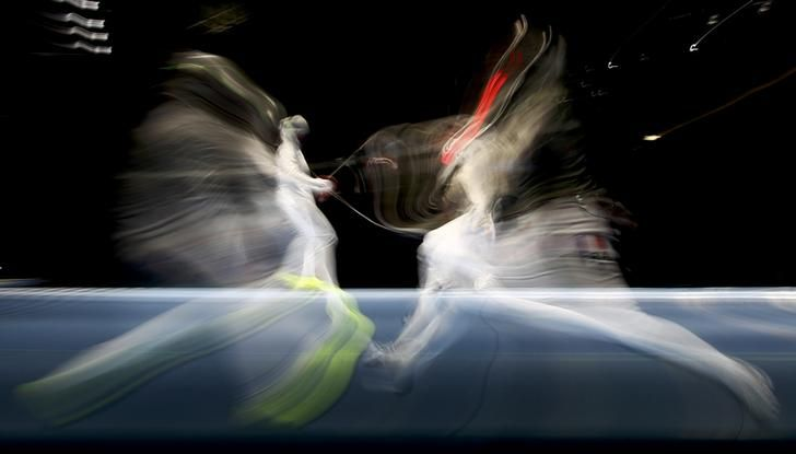 OLYMPICS-RIO-FENCING-W-SABREIND Sophia Velikaia of Russia competes with Cecilia Berder of France in fencing quarterfinals. REUTERS/Lucy Nicholson