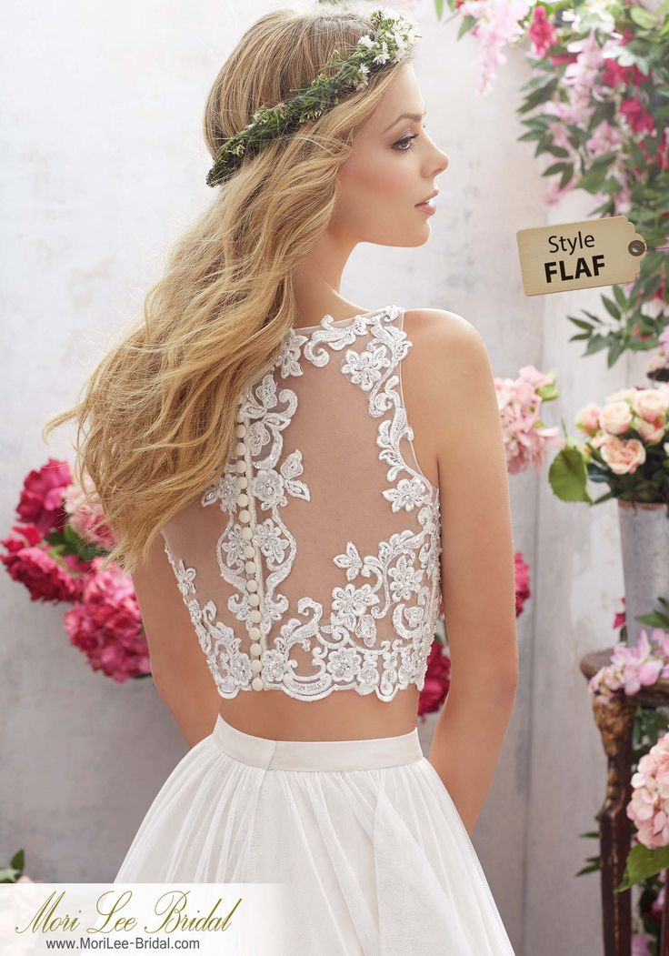 Style FLAF Melina Wedding Dress  Perfect for the Boho Bride, This Two-Piece Wedding Dress Features a Crystal Beaded, Embroidered Bodice with Soft Net Skirt. Illusion Back Accented with Covered Button Detail. Colors Available: White, Ivory, Ivory/Light Gold. Shown in Ivory/Light Gold.