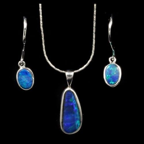 Opal Set 9024 matching set of green blue pendant and earring opals.lovely free form presentation including surgical steel chain. https://opalmine.com/product/opal-set-5/