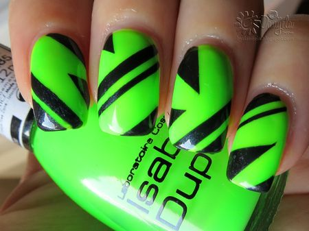 Trance music inspired nail art in neon green and black stripes via #danijela - bellashoot.com