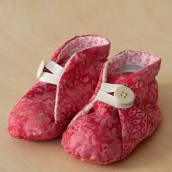 These adorable pink baby booties are perfect for a Valentine's baby, or any other little girl in your life.