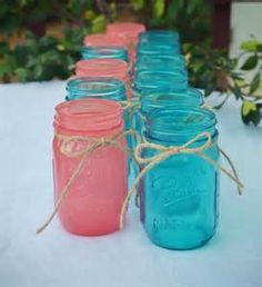 Mason Jars In Turquoise And Salmon Colour To Use As Part Of The Centrepieces Or For