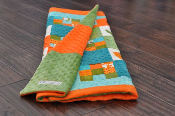Orange, aqua and green animal applique baby quilt. Patchwork and applique shapes, minky and flannel fabric. Modern and vibrant!