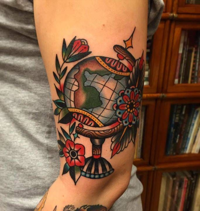 Traditional world globe tattoo on Nadina's left upper arm. Tattoo Artist: Kim-Anh Nguyen