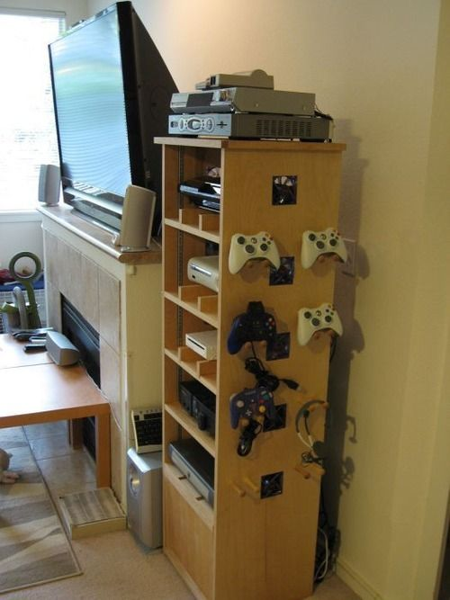 Awesome game shelf. Doesn't look like it would be that difficult to build. Lots of air flow.