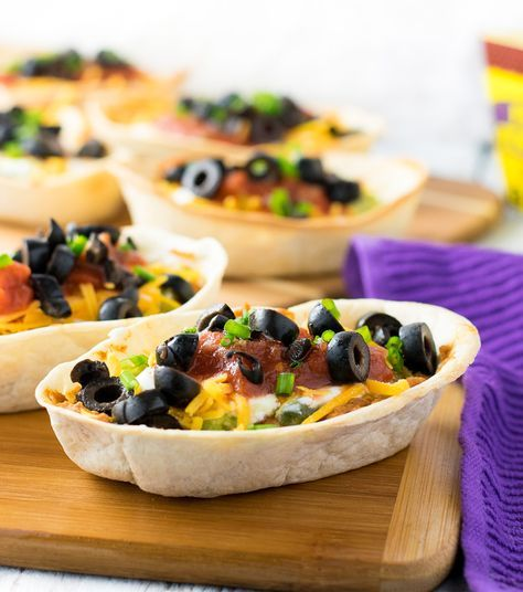 Individual Seven Layer Bean Dip Boats Prep Time 10 mins Cook Time 10 mins Total Time 20 mins Having a party? These Individual Seven Layer Bean Dip Boats are a fun twist on a classic appetizer, your guests will love having their own edible flour tortilla serving boats! Course: Appetizer Cuisine: Mexican Servings: 8 Ingredients 8 Old El Paso Flour Tortilla Boats 2, 16 oz cans Refried beans 1 oz Taco Seasoning packet 16 oz jar Salsa 8 oz Sour Cream 1/2 cup shredded Cheddar cheese 2.25 oz can…