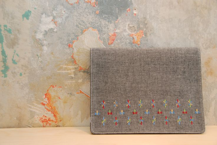 ipad case by 'white tales'. Made from natural cotton fabric and have embroideries inspired by Greek traditional costumes.