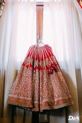 Real Indian Weddings - Rohan and Roshni | WedMeGood | Bright Red and Gold Shimmer Lehenga With Red Latkans | Bridal Lehenga by Sabyasachi Mukherjee | Photo Courtesy: DotDusk Studios