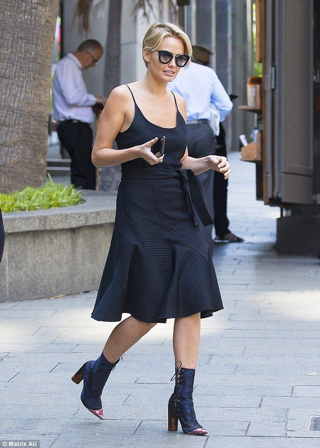New mother: Lara Worthington (nee Bingle) put her best fashion foot forward as she nipped ...