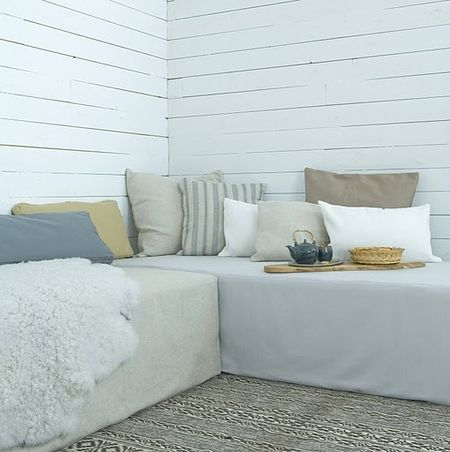 daybed idea using 2 twin beds on platforms.  Storage would be under each bed.