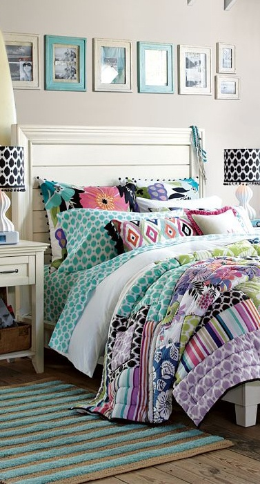 Bright colors with mixed patterns in this girl's room