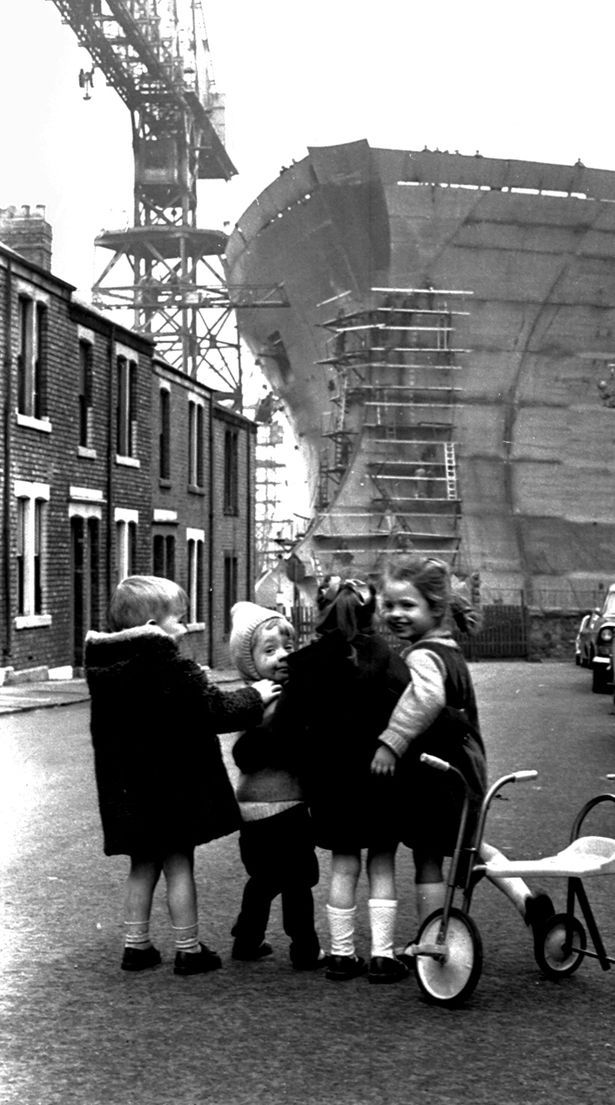 Children playing in the shadow of the giant oil tanker Esso Northumbria being built by Swan Hunter at the end of Leslie Street, Wallsend, in April 1969. From left, Paul Muir, Neil Stoker, Hazel Kendall (now McLean) and Pam Riley (now McAllister)