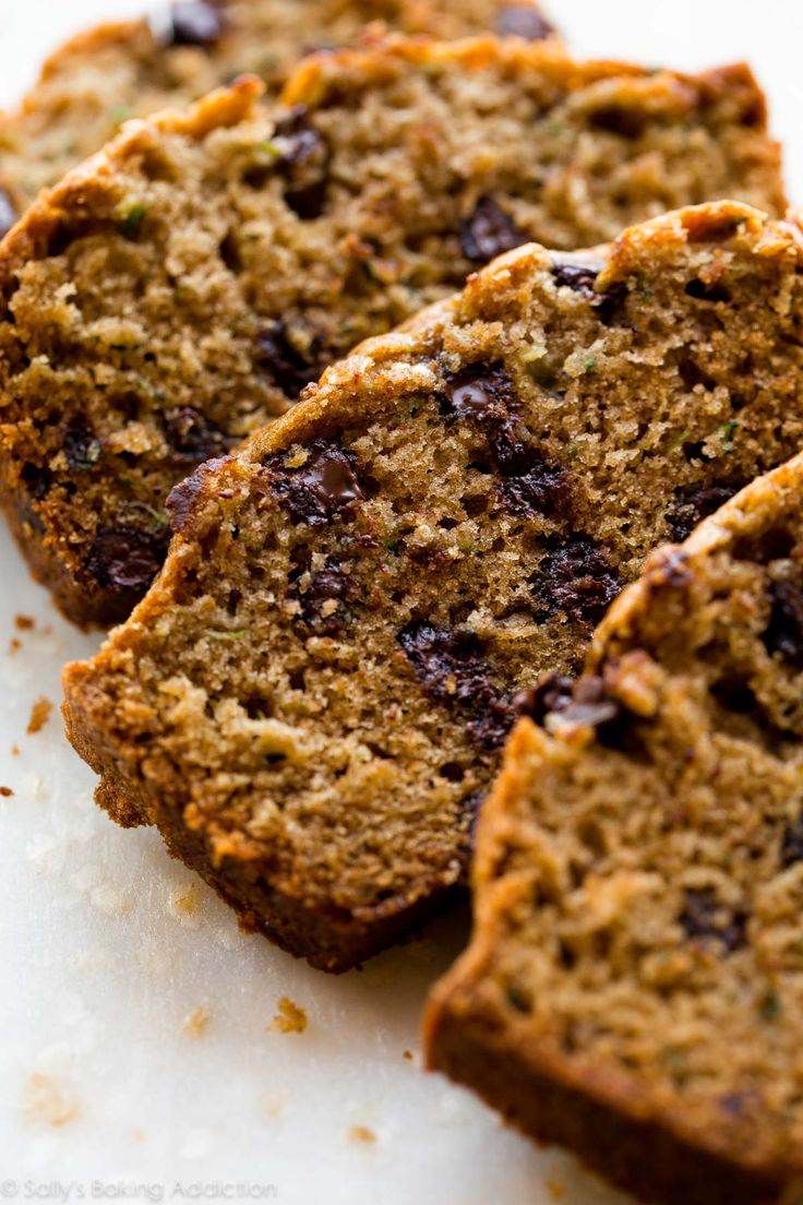 Here's an award winning recipe for zucchini bread + zucchini bread muffins! Filled with brown sugar and cinnamon, you can't taste the zucchini!