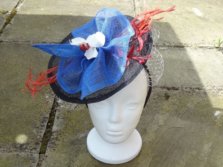 Quickie sinamay fascinator I made on the morning of my son's wedding!  Hand made orchid to decorate which matches all the other flowers I made for the buttonholes and cake.  A wonderful experience - the most fabulous day :)  The Himeji Castle wedding cake is in my board Fifi's Cakes