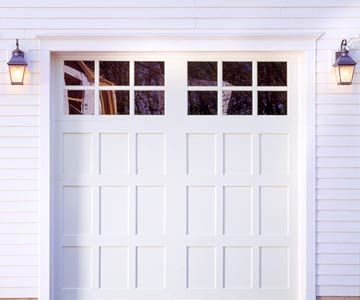 Garage door with twin glass panels. From www.bhg.com.
