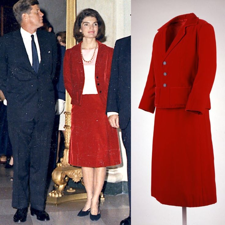 President John F. Kennedy and First Lady Jackie Kennedy attend a judicial reception at the White House on November 20, 1963. Jackie is wearing a red velvet suit designed by Oleg Cassini.