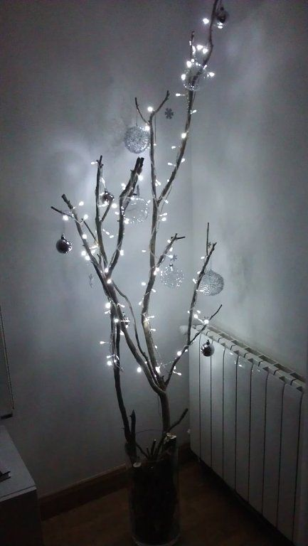 Christmas decoration idea! I heart lights on trees - or tree branches :)