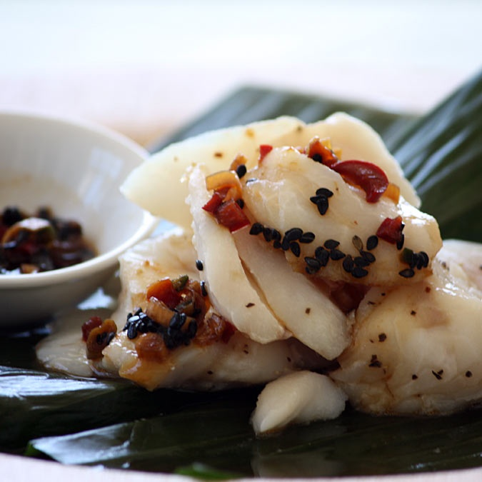 Fish steamed in banana leaf, with Korean dipping sauce