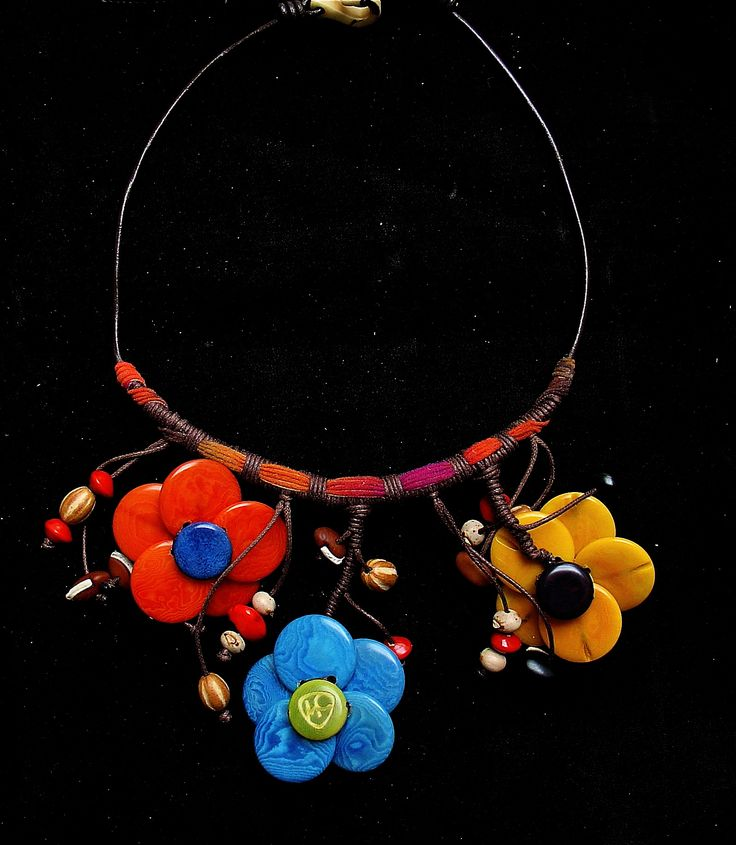 This necklace is part of the Orinoco collection which is based on the indigenous people of the Orinoco river in Venezuela. #necklace #ethnic #fashion #flowers #seeds #orinoco #indigenous #accessories #fashionforward #fashiondesign #unique #venezuela #colombia #timelessfashion