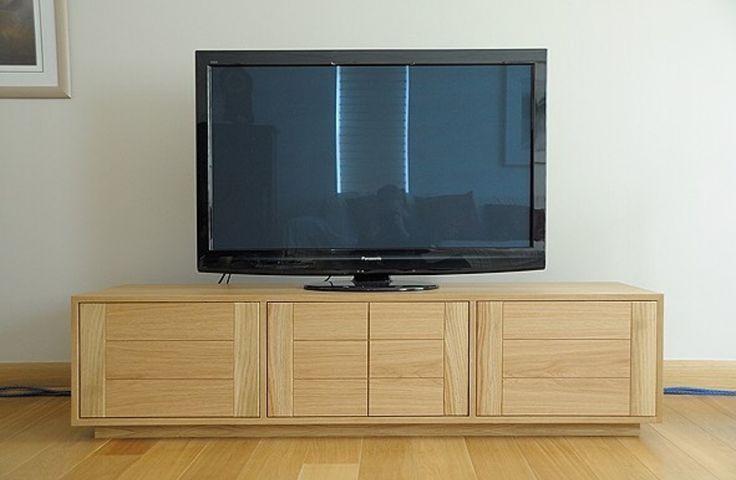 Av cabinet in oak. Tv cabinet. Custom made, bespoke. Retractable doors. Made to measure