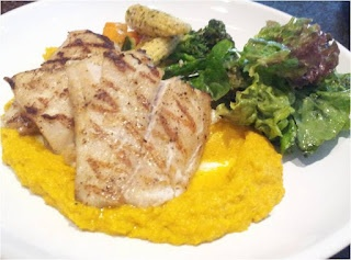 Spigola alla griglia di Bari (Grilled sea bass with vegetable sautéed in butter, garlic and pumpkin mash) during Eat-ly