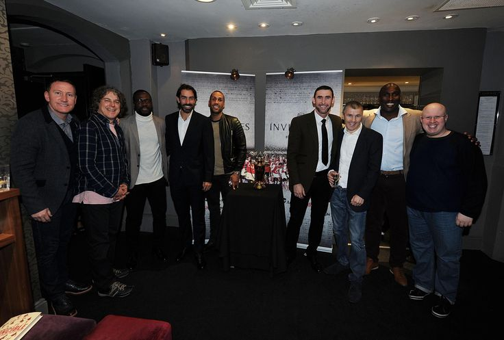 Ex Arsenal players (L-R) Ray Parlour, Lauren, Robert Pires, Martin Keown and Sol Campbell with (2ndL) comedian Alan Davies, (5thL) boxer James DeGale, (3rdR) boxing trainer Jimmy McDonald and comedian Matt Lucas at the Preview Screening of 'Invincibles'.