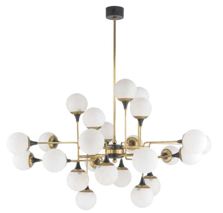 Lampadario anni 50 - Come scegliere il lampadario vintage per un arredamento anni 50 fra le mura domestiche.