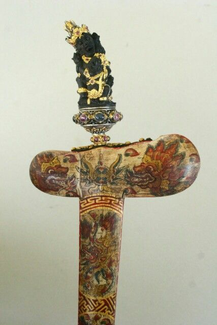 Intricate Balinese keris. Mixed influence with painted sheath.