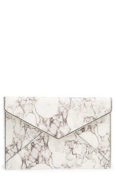 Free shipping and returns on Rebecca Minkoff 'Leo' Clutch at Nordstrom.com. A striking marbled finish adds upscale refinement to a clean-lined clutch framed with polished zipper teeth at the sleek envelope flap.