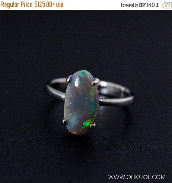 XMAS SALE Oval Australian Opal Ring - Blue and Green by OhKuol on Etsy https://www.etsy.com/listing/227588650/xmas-sale-oval-australian-opal-ring-blue