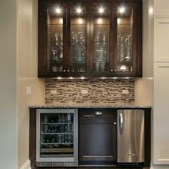 great space saving bar area or butler's pantry, love the cabinet lighting
