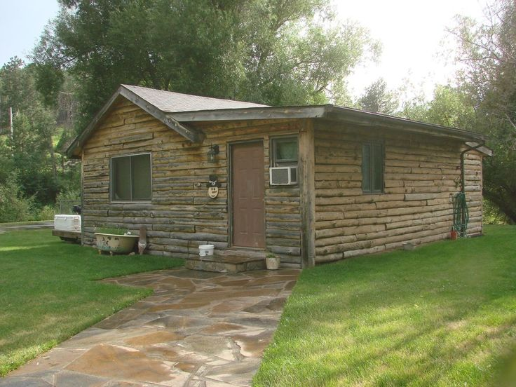 Its a rustic cabin on the outside and a modern cabin on the inside. When you walk in it has a full kitchen , full size appliances (stove - refrigerator- coffee pot - microwave - toaster) and all the dishes/pots and pans ...