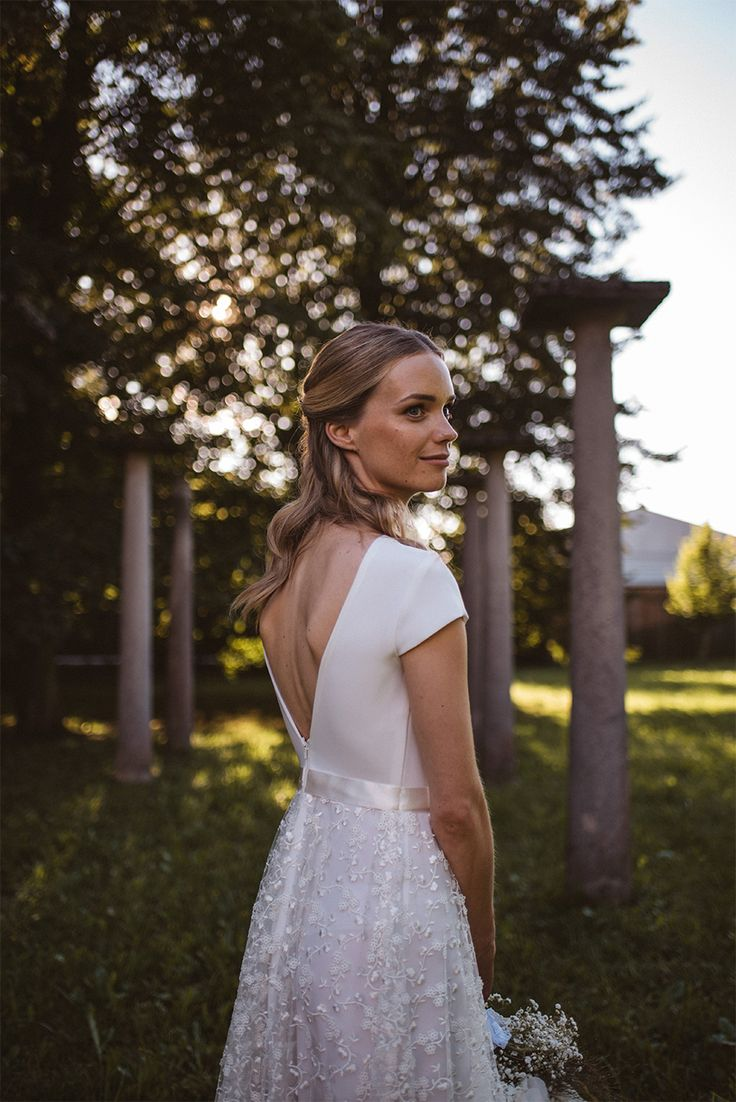 I love this pure wedding photo portrait of the bride in the park. Bride's beautiful dress was designed by eNVy Room .