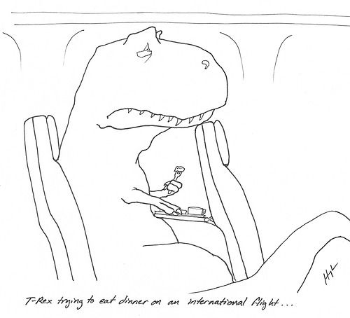 T-Rex Trying to eat dinner on an international flight…  #TRexTrying