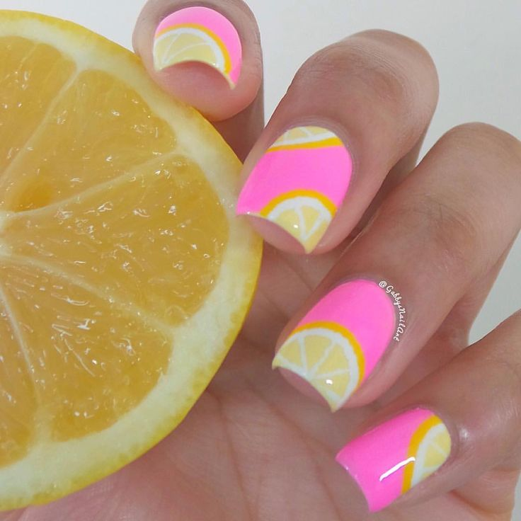 "Pink lemonade nailsColors used: LVX-""Lemon Drop"", @orlynails-""Out-Take"", @essiepolish-""Blanc"", and Wet n Wild-""D'oh!/Oups!"" (Only 3 days left for a chance to WIN 100 ESSIE POLISHES!! Make sure you click the link and vote for me to be entered!)"