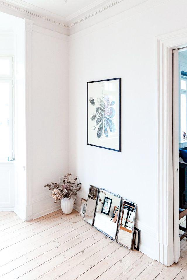 Art and frames on floor
