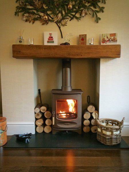 Wood burning stove slate hearth chunky oak lintel