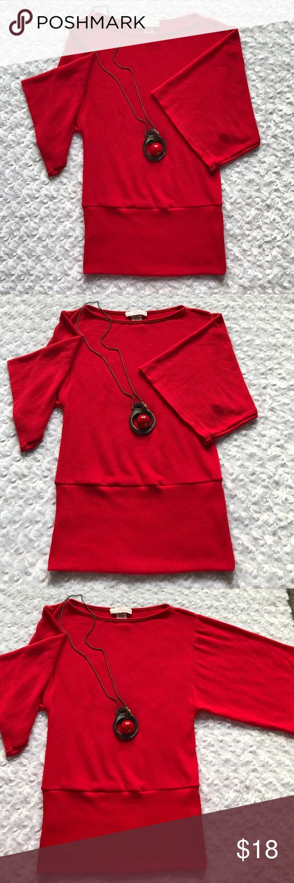 "CHERRY RED KNIT TOP Beautiful Cherry Red top with a boat neckline. Batwing style sleeves 11"" long. Bust 32/34"" Waist 12.5"". 62% Rayon. 33% Polyester. 5% Spandex. Great for work or day wear. Lipstick Tops"