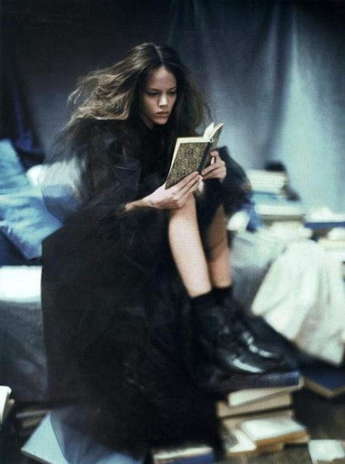 """Freja Beha Erichsen reading with boots on books. By Paolo Roversi in """"A Woman of Singular Charm"""" for Vogue Italia, November 2007.    Erichsen (Danish, 1987-)was discovered on the streets of her native Denmark by a modeling agent passing by in a taxi.    In 2008, casting agent James Scully said of Erichsen:""""The queen of cool. Probably one of the most-requested models of all my clients. She is the perfect old-school clothes-hanger with a little eighties androgyny thrown in."""""""