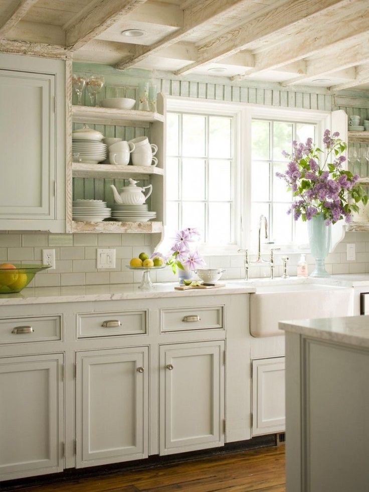 Cottage Style Kitchen With Whitewashed Wood Bright White Tiles And Sage Green Painted