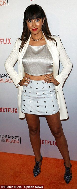 Peek-a-boo! Jackie Cruz flashed her taut midriff in a silver crop top paired with a white ...