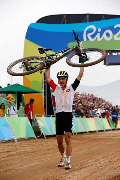 Nino Schurter of Switzerland celebrates winning gold during the Men's Cross-Country on Day 16 of the Rio 2016 Olympic Games at Mountain Bike Centre on August 21, 2016 in Rio de Janeiro, Brazil.