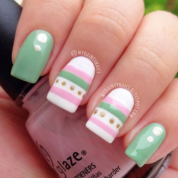 "Mint nail art design with gold dots and striped white accent nails ( ""Mint Menthe"" by Love & Beauty (by Forever 21), white polish from a brand called Arezia, ""Something Sweet"" by China Glaze and ""Golden-I"" by Sally Hansen)"