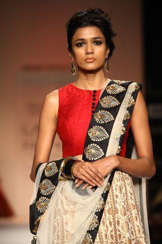 Red silk choli worn with gold banarsi cotton silk anarkali lehnga and ecru tulle dupatta with black silk embroidered border. SHOP THE LOOK: http://www.payalsinghal.com/off-the-runway/jahan-lehnga