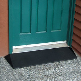 This black rubber ramp has tapered sides and doesn't look like ramp. $114