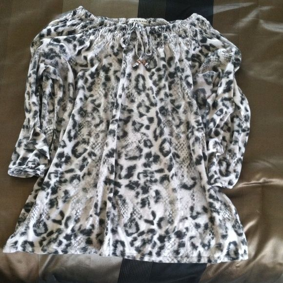 Hannah Off Shoulder Animal Print Top Unbelievably Comfy!  Elastic stretch can be worn off the shoulders or as a smock top. Hannah Tops Blouses