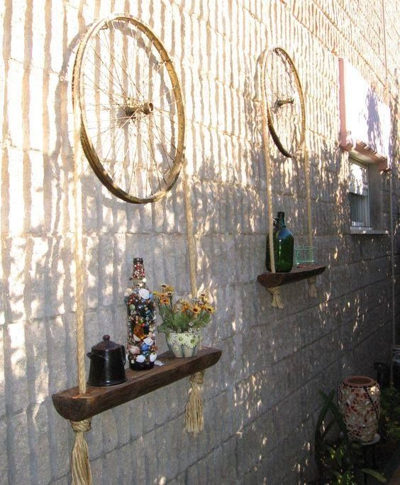 bike wheel shelf via Recyclart
